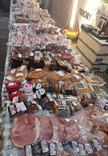 Priors Hall Farm's stall at a farmer market